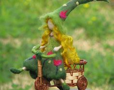 Needle felted Waldorf inspired Art doll Tulip fairy on a bike home decor