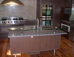 Raised glass eating bar on kitchen island | Calgary's House of Mirrors