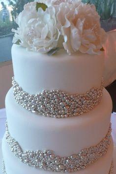 Classy white wedding cake.
