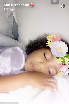 Sweet dreams: North west closed her eyes as she got ready to fall asleep