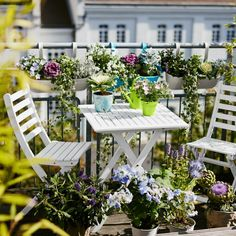 spring flowers balcony plant folding table chairs white terrace design