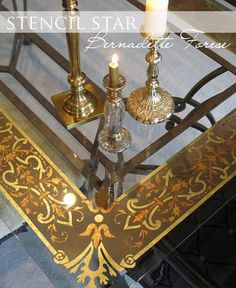 a reverse gilded glass finish. Here, she uses the technique on a gorgeous tabletop with a Modello™ Designs Ornamental Border vinyl stencil (OrnBo147) -- SO beautiful! Stencil: https://www.modellodesigns.com/Category.asp?cat_idno=3_idno=1248 The step-by-step how-to is available in the Art of Living book: http://www.royaldesignstudio.com/collections/books-videos/products/decorative-finishes-inspired-by-the-south-of-france
