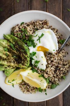 An easy and flavorful quinoa bowl topped with fresh avocado with za'atar, poached eggs, fresh lemon juice, and a drizzle of olive oil.