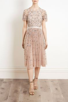 A signature style for Needle & Thread, the backless Comet Dress features all-over embellishment of iridescent sequins and silver cut beading. This embellished tulle midi length dress has a pretty sleeve detail and the faded rose shade keeps it fresh and playful. Also available in a longer length gown.