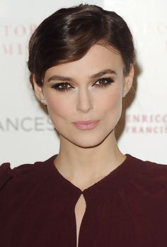 Copy Keira Knightley's sophisticated look by using lashings of mascara on your upper and lower lashes and using blusher and highlighter to define your cheekbones.