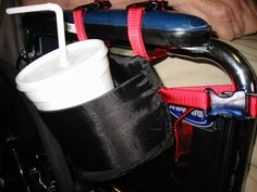 A DIY project for a Custom Cupholder on a Wheelchair. The bottom of the holder is halfmoon shape cut from flexible plastic cutting board material and the fabric is nylon sports material. This product is angled so that the cup will tilt but not fall out. This is so that the cup clears the armrest when lifting a drink out of the cup holder. The nylon material is easily cleanable and can be smashed without any damage specifically if client has visual neglect.