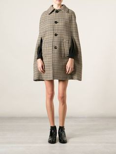 Saint Laurent houndstooth cape at farfetch.com. Over 1000 designers from 300 boutiques in one website. #saintlaurent