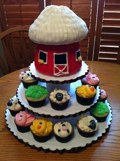 Barn is giant cupcake mold, animals heads are fondant.