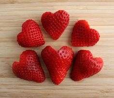 Strawberry Hearts  Strawberries are a perfect addition to a Valentine's lunch because their bright red color and natural heart shape easily lend themselves to the theme. To accentuate the shape, hull a strawberry, cut it in half vertically and then make a small V-shaped notch at the top of the berry using a knife.