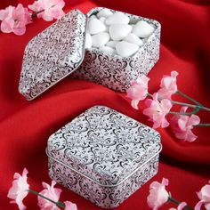 The Damask Design Mint Tin Favor is beautifully crafted and is a classic choice for any black and white themed bridal shower, wedding or any other special event such as an anniversary or birthday celebration. The outside surface of the silver metal mint tin is coated white and is embellished with a black damask design. The hinged lid opens to reveal sweet surprises hidden inside! Measuring 2-in. square and 1-in. tall, it can hold a handful of small candies, such as M