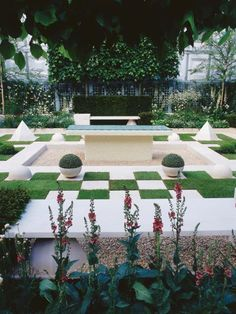 Adapt classical symmetry to meet the needs of modern living, such as space for outdoor entertaining or for growing herbs. Take your design up a notch by getting to know a wide range of landscape materials and the ways they can be combined.  A checkerboard of white paving and emerald grass against a dark hedge offers a modern interpretation of a traditional format.