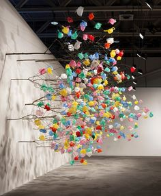 Cameroonian artist Pascale Marthine Tayou created his latest installation at Art Basel Unlimited 2015 by building a giant tree that produced plastic bags. The tree is not only supposed to stand as a representation of the harmful effects of pollution, but also ''an investigation towards the artistic qualities of plastic as a medium, and its incorporation with natural materials'.