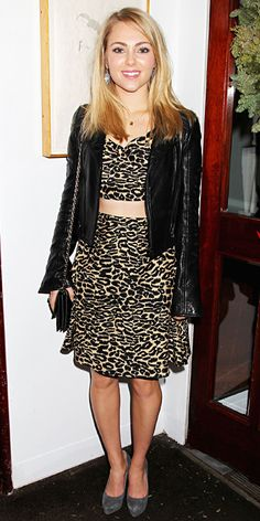 The Carrie Diaries star Robb embraced her wild side and wore a leopard print crop top and a matching pencil skirt, topping it off with a bla...
