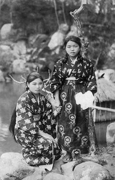 thekimonogallery:    Two Japanese country girls in kimonos that are very different than those of their urban counterparts: these garments are of cotton utilizing the kasuri (ikat) technique) . This photo is unidentified, but likely was taken during the early Showa period, 1927-1940