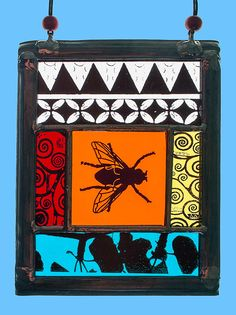Stained glass Suncatcher with kilnfired fly motif and ornaments, stained glass insects, nice glass gift. Available at the Etsy Shop of Stained Glass Elements.
