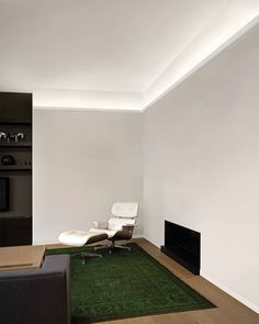 Minimalistic living space design with Sunrise molding and indirect lighting; living room lighting ideas | modern interior design