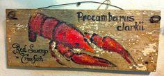 """Red Swamp Crawfish"" on cool old wood"