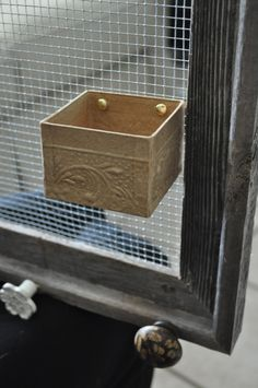 I love this idea and will incorporate the drawer knobs and tin box into my jewelry frames from now on.