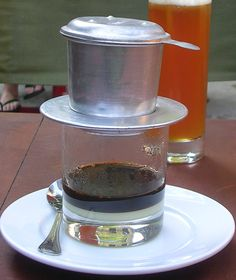 Vietnamese coffee, I have this and it's great.  Put a tiny bit of sweetened condensed milk in the bottom before dripping and it's so strong and tasty☕