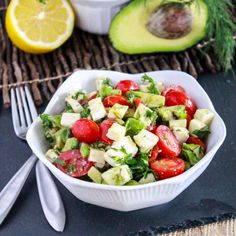 A simple salad with fresh mozzarella, avocado, and grape tomatoes tossed with olive oil and lemon juice.