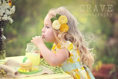 This whole styled session is amazing!  I love the flower piece in her hair.  =)