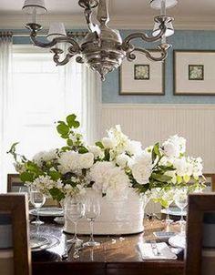 white galvanized bucket with white flowers