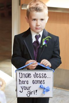 Ring Bearer with sign instead of pillow. Wedding Pic. Photo by Kristin Hansen Photography