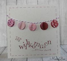 Eine fröhliche Karte mit kleinen Lampions zur Geburt.  Zur Karte gehört ein weißer Umschlag.