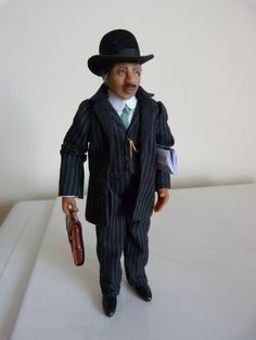 Businessman - 1/12th scale dollhouse miniature via Etsy. Artist Jo Medvenics.
