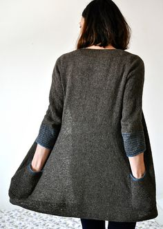 grey long cardigan, pockets.