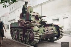A German soldier inspects an abandoned French AMC-35 medium Cavalry tank, one of the few to see service with the French Army in the last days of the German offensive of 1940. Besides the 40 something that fought under the French flag, around a dozen were sold to Belgium of which 8 equipped an Armoured Car Squadron.