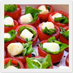 Bite Sized Caprese Salads  Mini Caprese Salad Bites  1 large package of cherry tomatoes  1 container pearl sized buffalo mozz  1 bunch of fresh basil  Kosher salt and pepper  Extra virgin olive oil  Balsamic vinegar