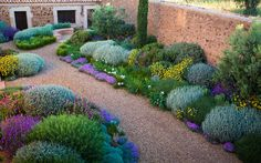 Garden Design magazine is filled with stunning photographs of gorgeous plants and gardens, insights from the best designers, and stories from avid gardeners who are creating incredible outdoor spaces. Mediterranean Garden Design, Tuscan Garden, Farmhouse Garden, Low Water Landscaping, Outdoor Landscaping, Outdoor Gardens, Landscaping Ideas, Gravel Garden, Garden Planters