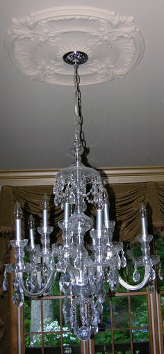 Strass crystal chandelier in the dining room. We're not ones for fancy state occasions, so I enjoy the chandelier most for the way light bounces off it during the day. On winter evenings when the icicle lights on the front porch are on, the drops on the chandelier sparkle with little rainbows that dance throughout the room...