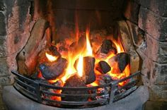 an open coal fire...the coalman, the coal bunker, the coal scuttle, soot down the chimney landing on the carpet.....coal - I can smell it now