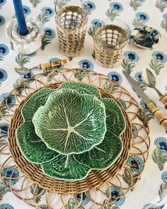 Cabbageware table setting by Katie Armour Taylor of instagram @katiearmour Lettuceware place setting with seagrass wrapped glassware tumblers Tory Burch Dodie Thayer candle holders, rattan place mats, India Amory block print table cloth, and bamboo flatware
