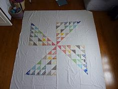 Half Square Triangles in a pinwheel layout
