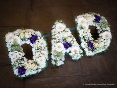 A grouped Dad tribute in creams and whites with a hint of purple. (Click Image To Enlarge) - Subject to availability. Funeral Floral Arrangements, Flower Arrangements, Dad Funeral Flowers, Funeral Sprays, Cemetery Decorations, Funeral Tributes, Memorial Flowers, Cemetery Flowers, Sympathy Flowers