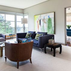 eclectic living room by Cheryl Burke Interior Design ... this is totally my design ascetic. I love the space and simplicity of this design. It also has a lot going on with the shapes of the furnitue etc.