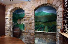 Custom mural of vineyard in wine cellar.