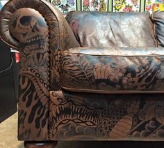 Check out this awesome tattooed sofa that will surely fit right in your home! Made exclusively by the talented hands of Gina McQuen. Diy Furniture Covers, Funky Furniture, Leather Furniture, Unique Furniture, Leather Sofa, Tattoo Shop Decor, Tattoo Studio Interior, Tatuagem Old School, Home Tattoo