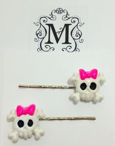 Girly skull barrettes! What more can be said?  These barrettes are completely handcrafted with quality polymer clay, sealed with a protective coating for a beautiful shine. Choose from either black or white or contact me for custom colors!