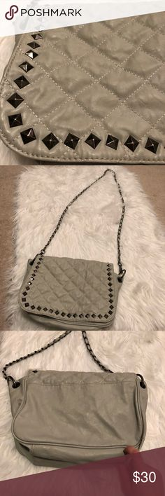 Steve Madden studded cross body Studded cross body by Steve Madden. Quilted print and black studs. This has a chain on it to make it a crossbody but can also be worn just on the shoulder. The middle compartment is torn but the bag is still functional. There is a small zip compartment under the Steve Madden tag and the bag holds a lot of items. Can push the middle compartment to the side so it is just one large compartment. Steve Madden Bags Crossbody Bags