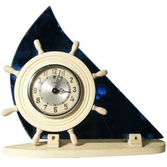 Art Deco Cobalt Blue Glass Sailboat Electric Clock by Victor | From a unique collection of antique and modern clocks at https://www.1stdibs.com/furniture/decorative-objects/clocks/