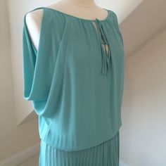 NWT BCBGMaxAzria Dress NWT BCBGMaxAzria Dress...draped split sleeves expose shoulder...light aqua...pleated skirting lined in nude chiffon...gathered elastic waist...tie front collar...dry clean only. Retail $268 BCBGMaxAzria Dresses Midi