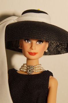 Holly Golightly in Breakfast at Tiffany´s Audrey Hepburn OOAK doll repaint using the Mattel BAT doll. Hair restyled, outfit Mattel. Made by Lulemee.