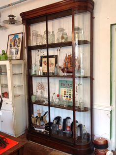 Fabulous cabinet filled with vintage glass bottles.