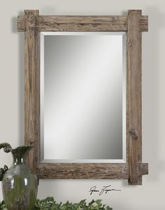 "Mirror has a 1-1/4"" bevel in a stained walnut frame that features a light rustic burnished detail finish. Contact us to purchase. 29 W X 39 H X 2 D (in)"