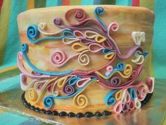 I believed that is quilled fondant... wow... cute bird... I might have to try that with paper ;-)