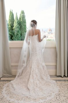 real wedding photo destination wedding in florence tuscany italy bride in lace wedding dress and veil looking at duomo view Tuscany Italy, More Photos, Terrace, Weddings, Wedding Dresses, Fashion, Balcony, Bride Dresses, Moda